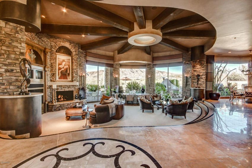 Luxury living room with large layout and spoke wood beam ceiling