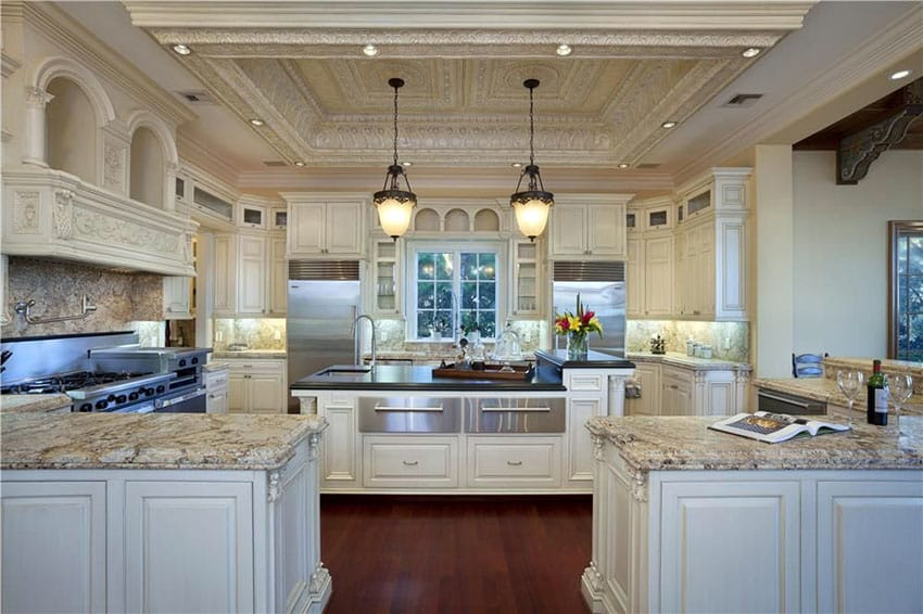 Luxury traditional cream color cabinet kitchen with peninsula and island with granite counter