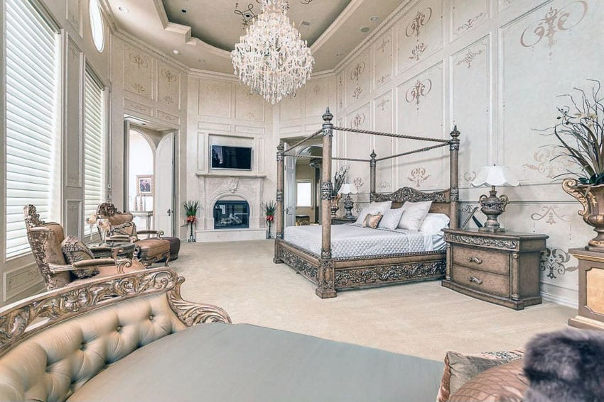 Luxury traditional master bedroom with gilded bed frame, high ceilings and crystal chandelier