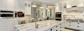 luxury-transitional-kitchen-with-white-cabinets-calacatta-marble-counter-espresso-oak-hardwood-floors-and-metal-pendant-lights