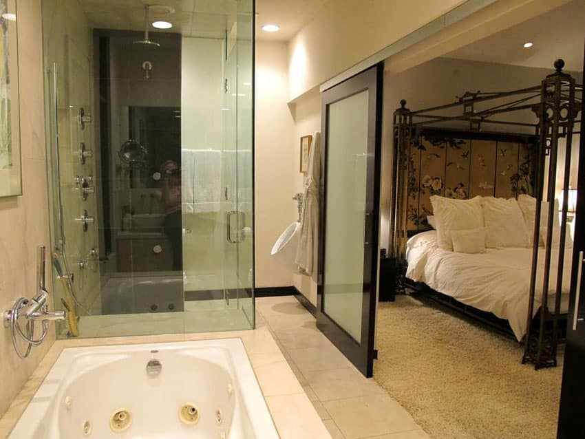 Master bathroom with modern sliding barn door with frosted privacy glass