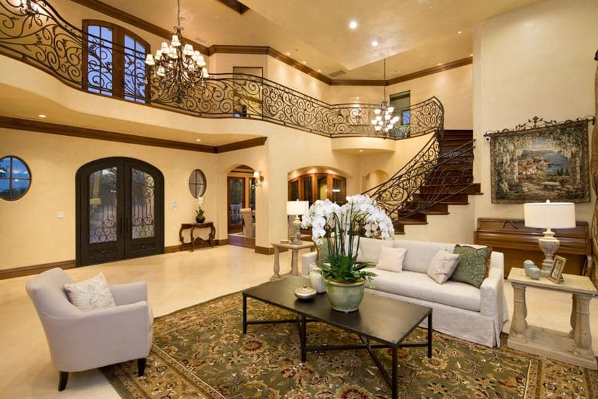 Mediterranean living room with foyer and grand wrought iron staircase