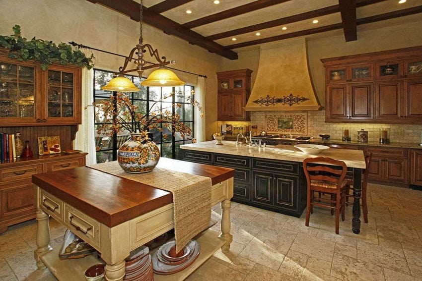 Country style kitchen with crema cappuccino marble island, butcher block island and antique travertine floors