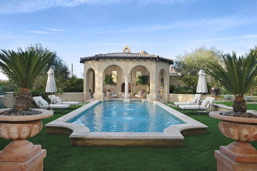 Mediterranean style swimming pool with large ornate octagon gazebo