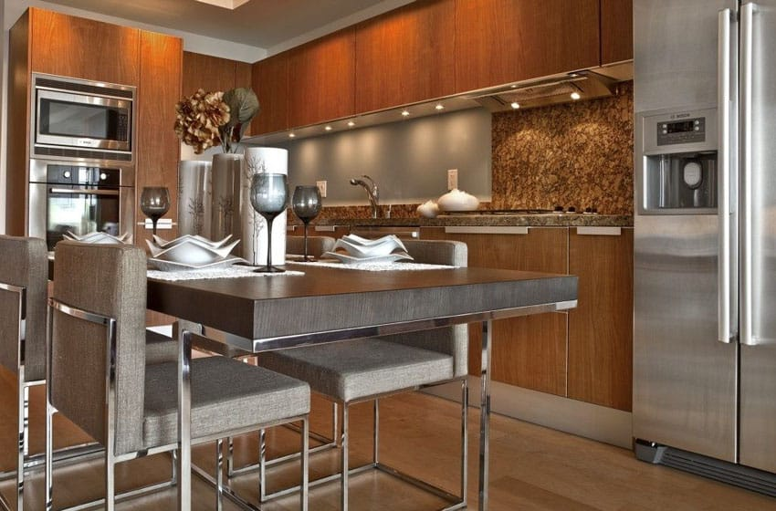Modern kitchen with brown cabinetry and small dining table