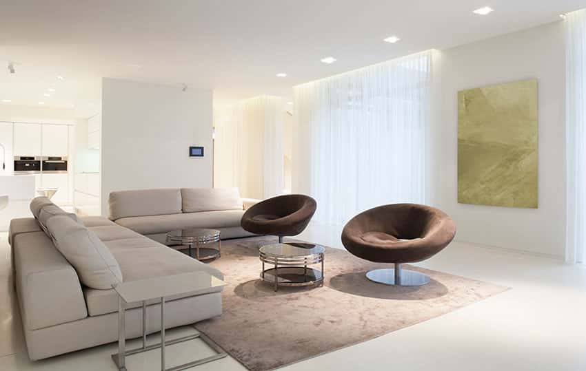 Modern living room with cream sofas and brown barrel chairs
