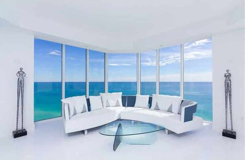 Modern white living room with expansive oceanfront view