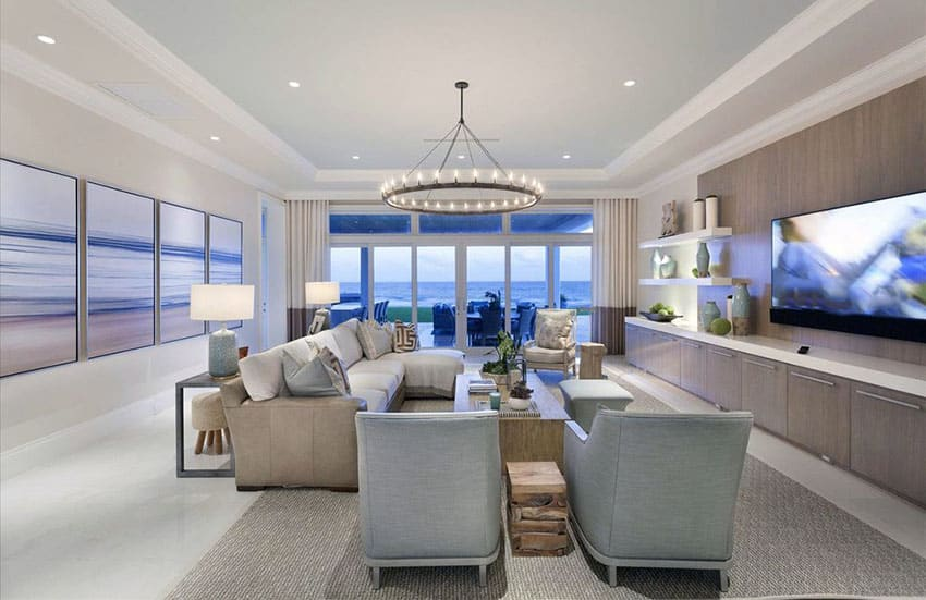 Ocean view living room with contemporary design and circular chandelier