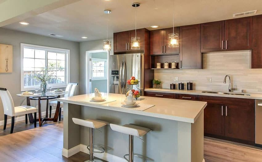 Open contemporary kitchen with dining nook and breakfast bar