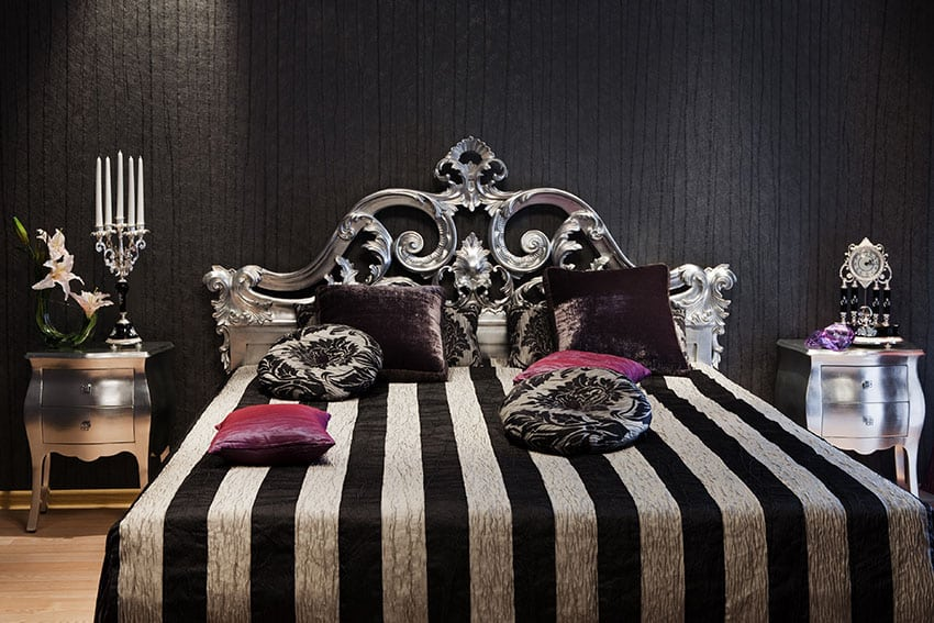 Romantic black bedroom with silver gilded bed frame and silver night stands