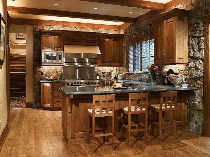 Rustic kitchen with sapphire blue granite counter peninsula and oak flooring