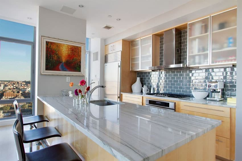 Small contemporary apartment kitchen with marmara white marble counter and breakfast bar peninsula