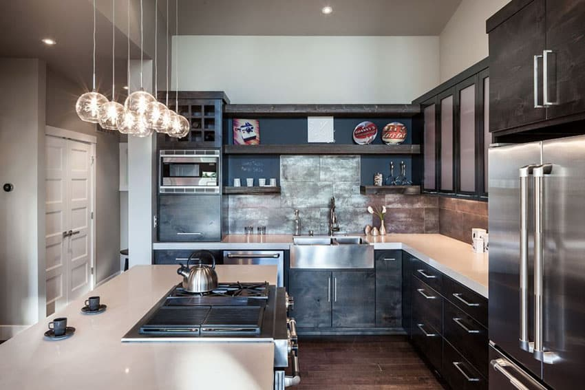 small contemporary kitchen with dark cabinets light countertops and