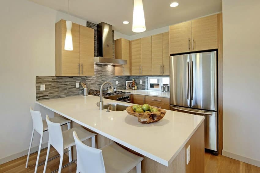 Small contemporary kitchen with peninsula and diamond white quartz counter