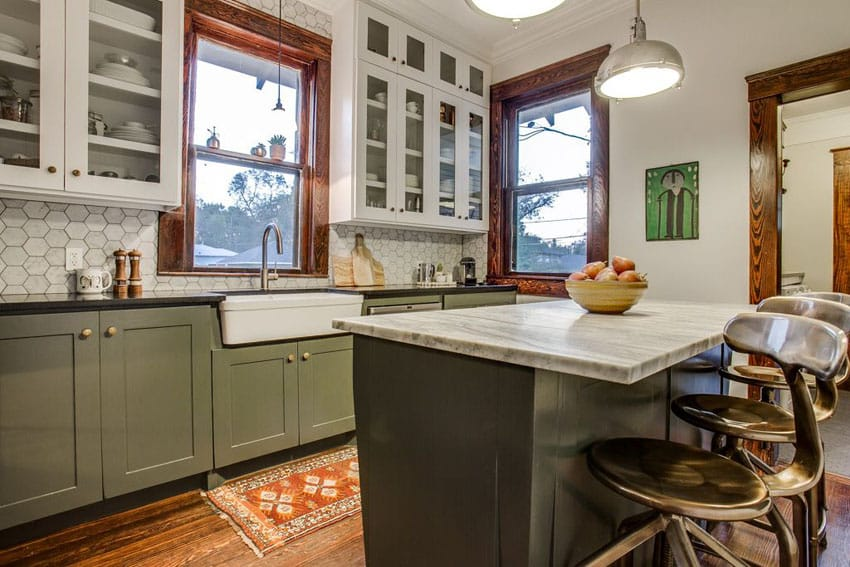 Small cottage kitchen with green cabinetry island, glass faced cabinets and farmhouse sink