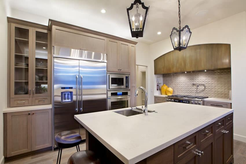 Small luxury kitchen with island and bora bora beige quartz