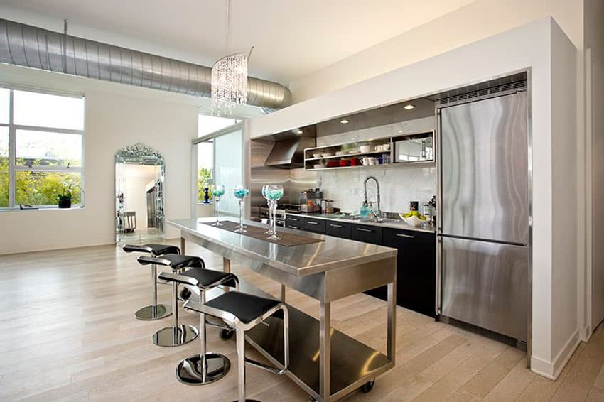 Small one wall modern kitchen with rolling stainless steel island