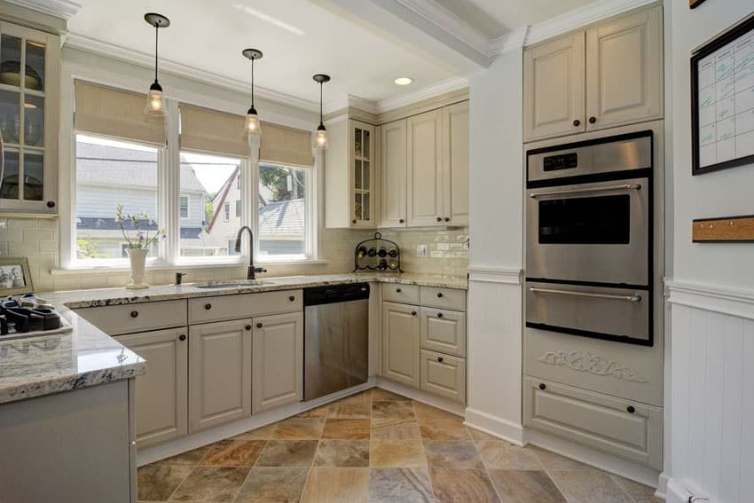 Small traditional kitchen with blizzard granite counters and windsor cabinets