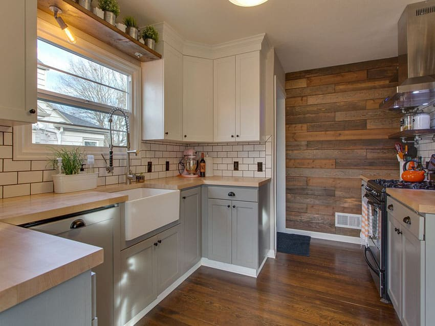 Small u shaped country kitchen with reclaimed wood accent wall and subway tile backsplash