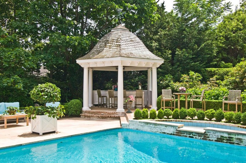 Swimming pool with gazebo with bar area and bar stools
