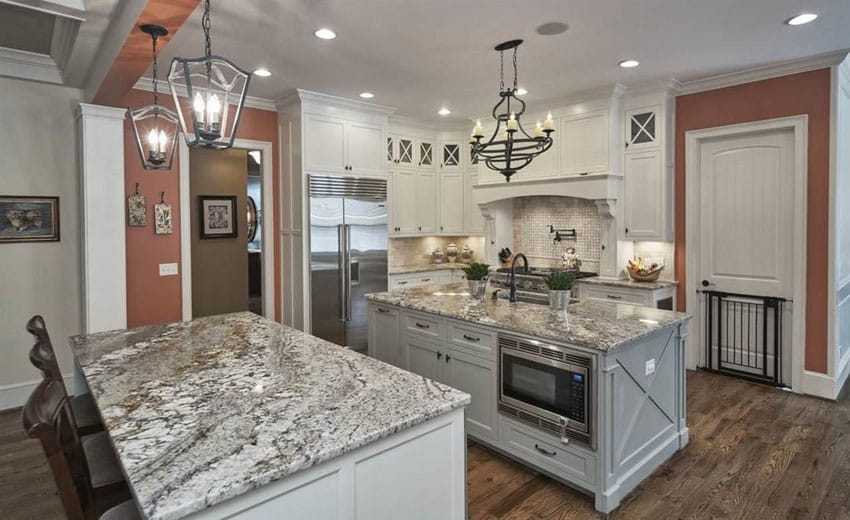 Traditional kitchen with avalon white granite, two islands for food preparation and dining and sink and microwave