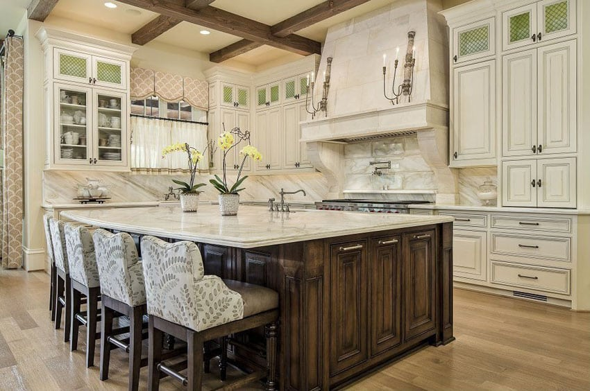 Traditional kitchen with bianco carrara marble and breakfast bar island with counter stools