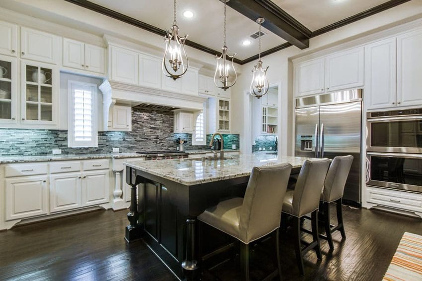 Traditional kitchen with blizzard granite topped island with breakfast bar seating