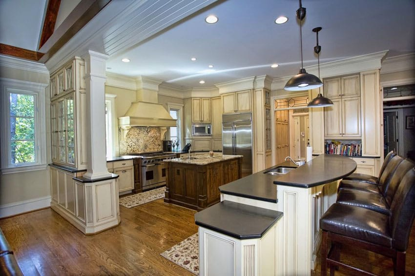 Traditional kitchen with cream cabinets, white cabinet breakfast bar with absolute black granite