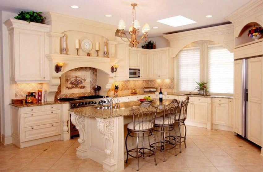 Traditional kitchen with cream color cabinets, decorative wood island and ceramic tile floors