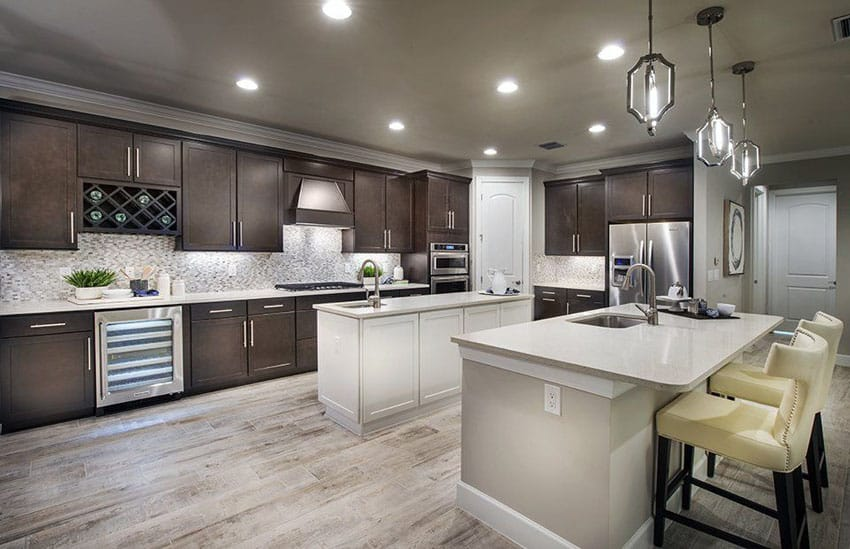 Traditional L shape kitchen with dark cabinets, two islands and wood style porcelain tile flooring
