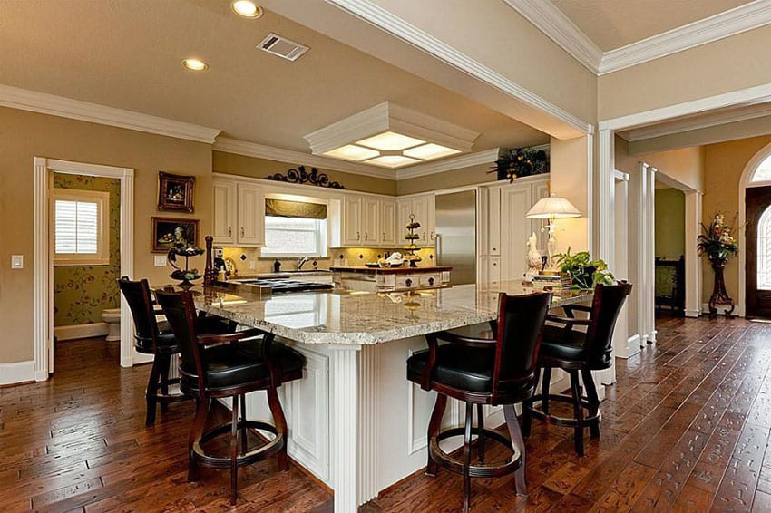 Traditional kitchen with l shaped peninsula and new venetian gold granite counter