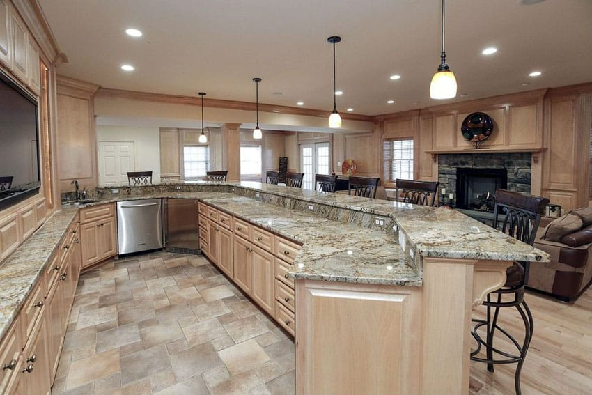 Traditional kitchen with raised panel cabinets in light wood color with peninsula dining