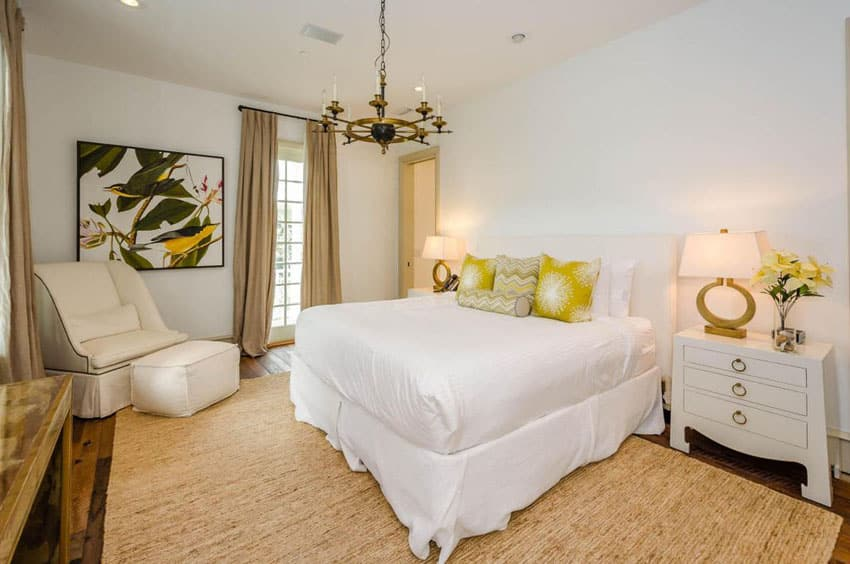 master bedroom with white furniture and yellow accent color decor