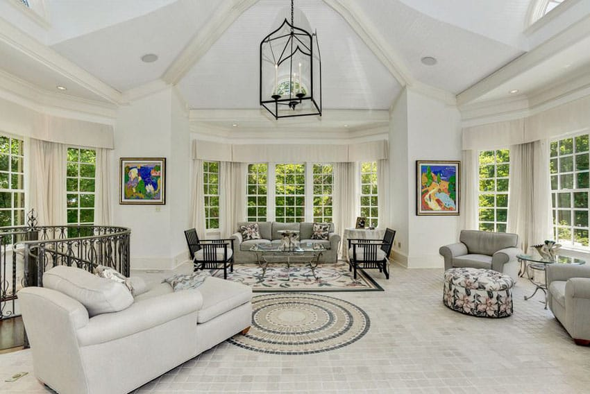 Traditional white living room with picture window views and vaulted ceiling