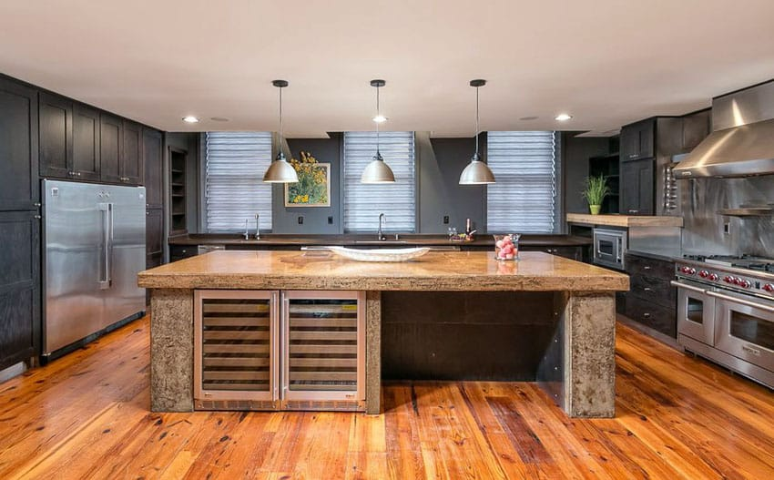 Transitional kitchen with black cabinets, concrete counter island, wood floors and high end appliances