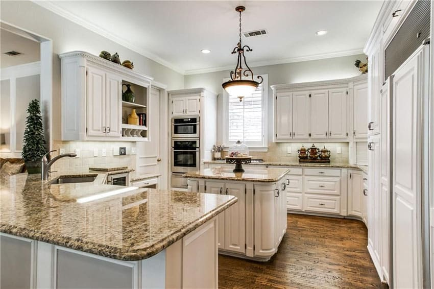 White cabinet kitchen with boreal granite counters and peninsula and island