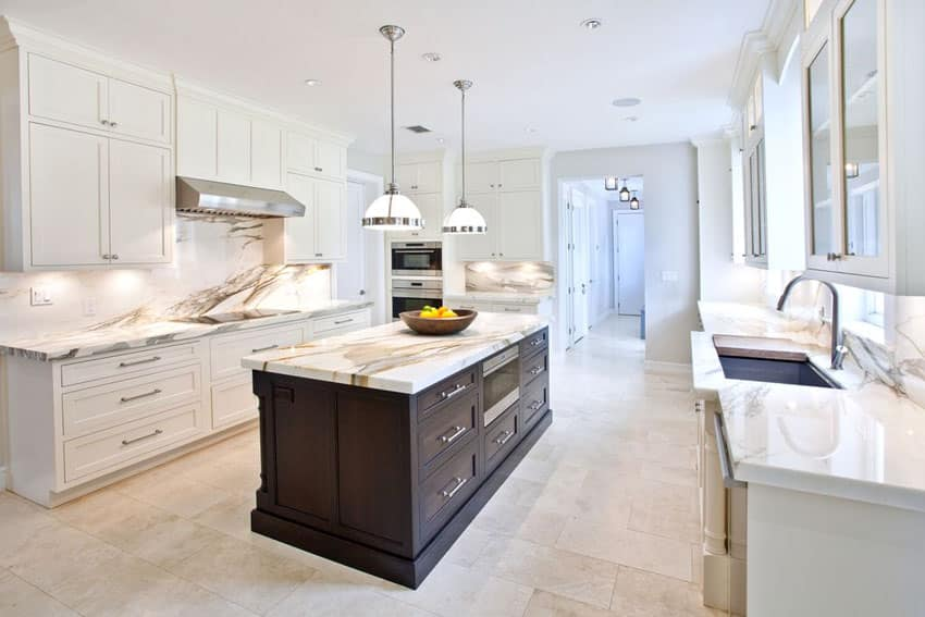 White transitional kitchen with brown cabinet island, calacatta gold marble counters and classic pendant lights