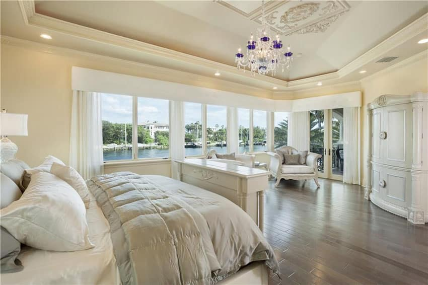Beautiful master bedroom with white furniture wardrobe and canal views