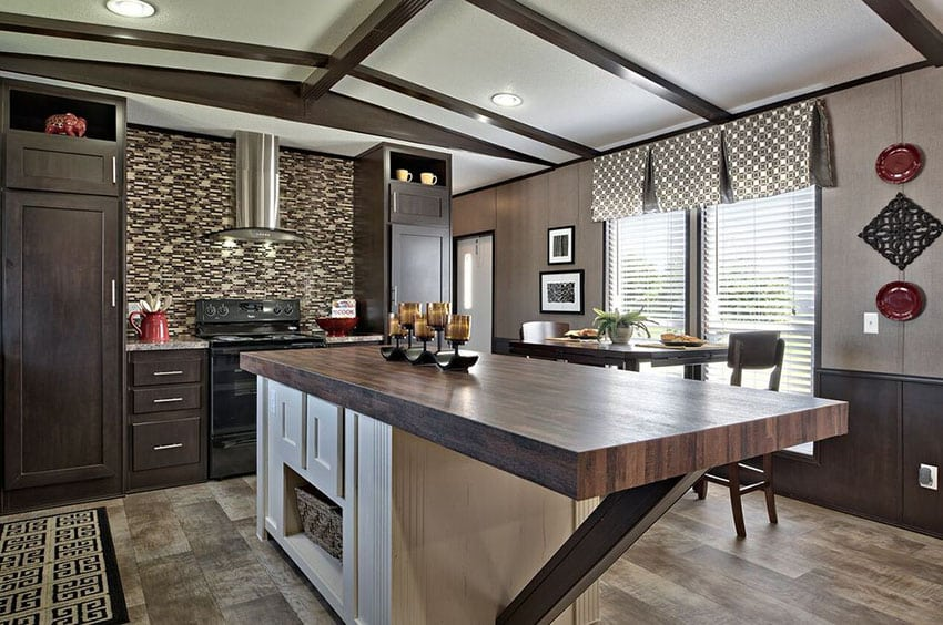 Contemporary kitchen with custom wood countertop island, mosaic tile backsplash and dark cabinets