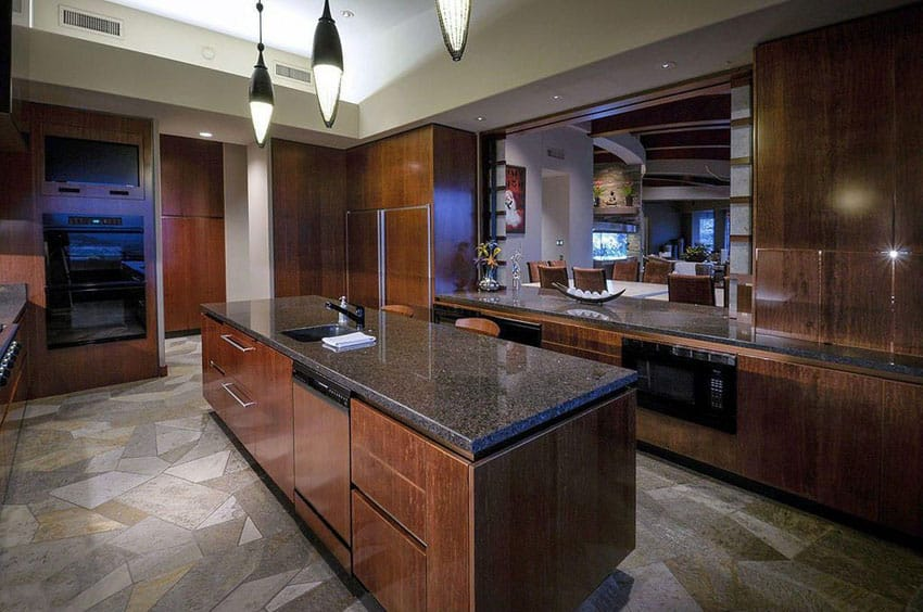Contemporary kitchen with dark European style cabinets and dark honed granite counters