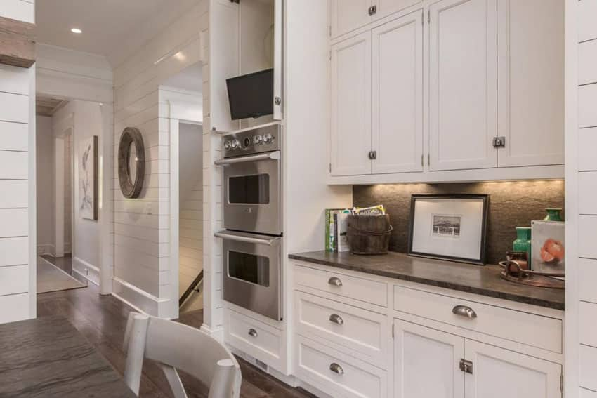 Cottage kitchen with one wall white shaker cabinets and grey marble backsplash
