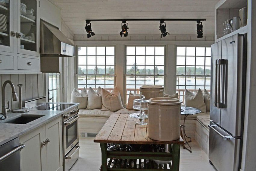 Cottage style kitchen with portable reclaimed wood style island