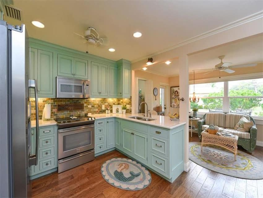 Country kitchen with arctic white quartz counter and mint green cabinets