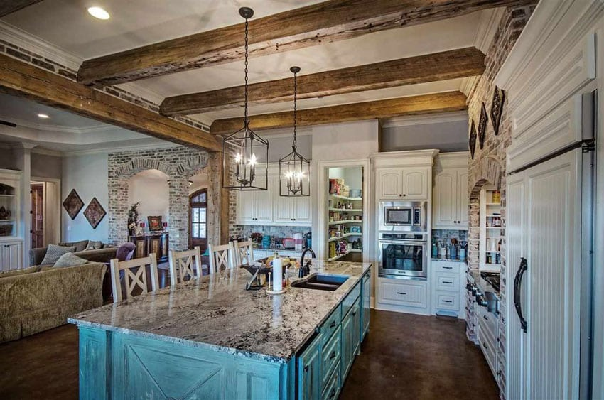 Country style kitchen with painted blue island, porcelain tile floors and granite island