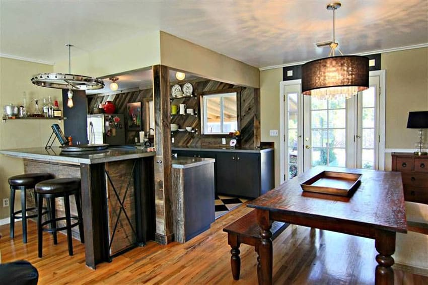 Eclectic kitchen with reclaimed wood cabinets and island
