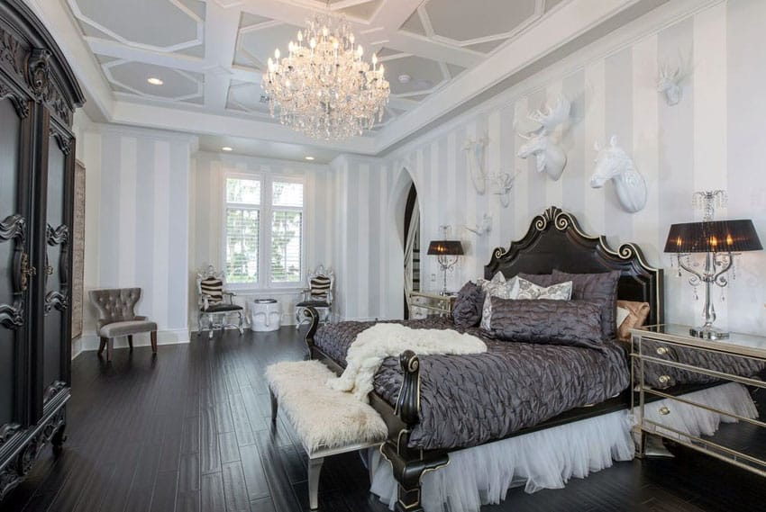 Eclectic luxury bedroom with dark wood floors and silver furniture pieces