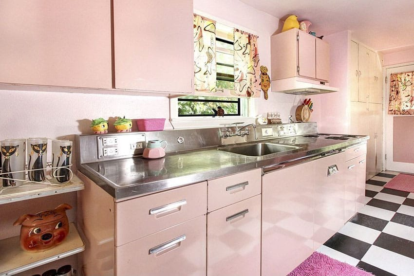 Eclectic pink kitchen with retro cabinets and one wall design