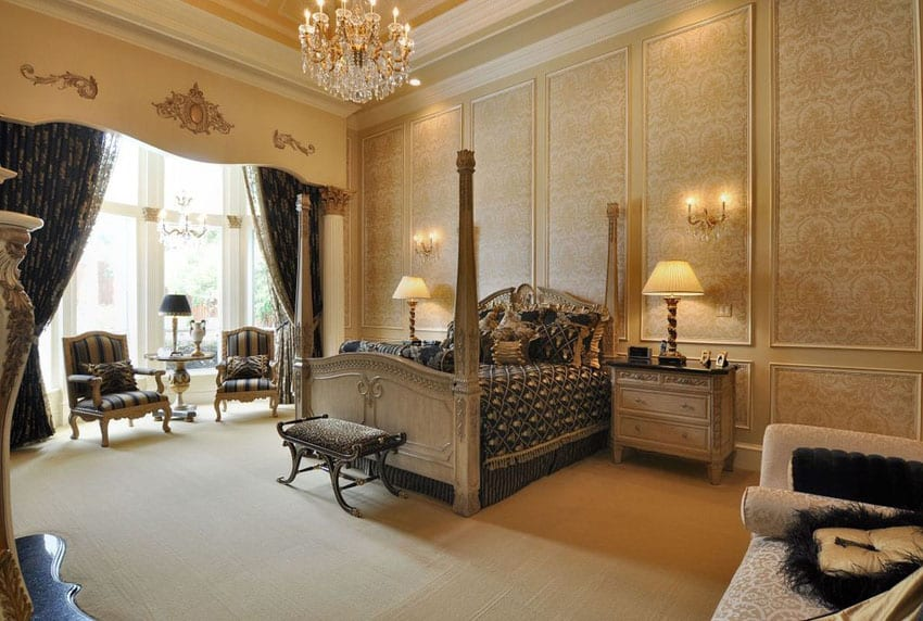Elegant french provincial bedroom with four poster bed, high ceilings, sitting nook and chandelier