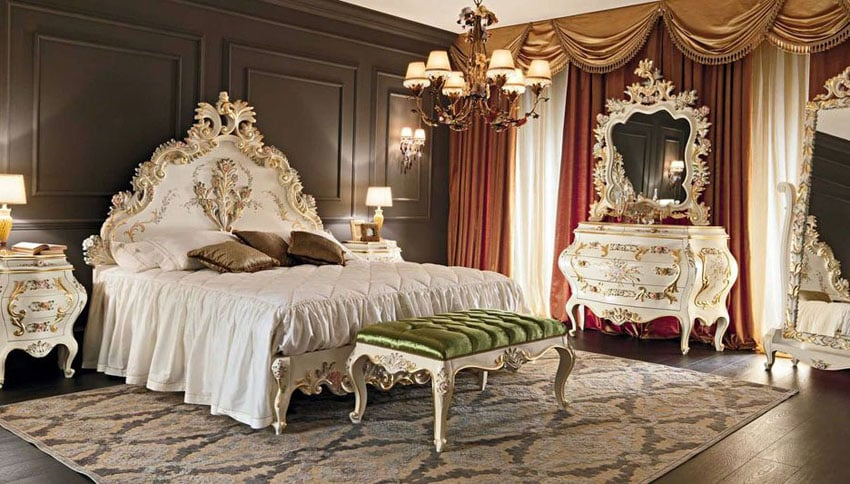 French provincial bedroom with elegant white dressers, bed frame and mirror with gold gilding