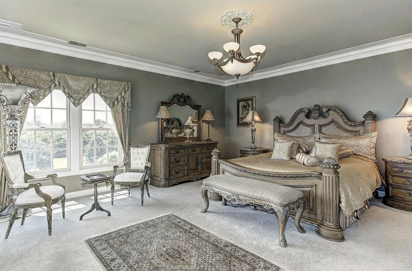 French provincial style bedroom with elegant furniture pieces and decorative wood bed